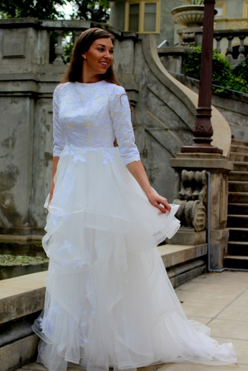 Front View of Alexandra Tznius Ivory & White Modest Wedding Dress with Sleeves