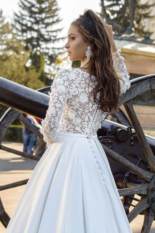 ,made of ivory satin-taffeta fabric.Sleeves and Back of the dress made of beaded 3d lace.Dress has long beautiful train and decorated with small buttons on the back.Clasp:buttons,zipper