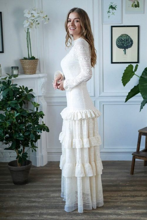 Side View. Bohemian Lace Tiered Skirt High Neckline White Lace Modest Wedding Dress