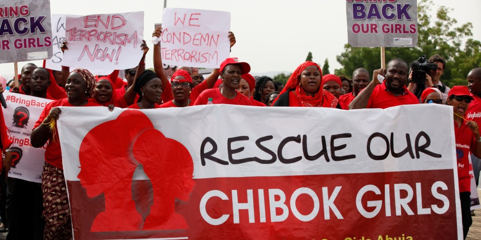 """People attend a demonstration calling on the government to rescue the kidnapped girls of the government secondary school in Chibok, in Abuja, Nigeria, Thursday, May 22, 2014. Scores of protesters chanting """"Bring Back Our Girls"""" marched in the Nigerian capital Thursday as many schools across the country closed to protest the abductions of more than 300 schoolgirls by Boko Haram, the government's failure to rescue them and the killings of scores of teachers by Islamic extremists in recent years. (AP Photo/Sunday Alamba)"""