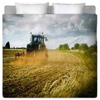 tractor ploughs field duvet cover