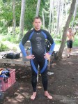 learning to scuba dive - wear a wetsuit for the first time while getting padi certified