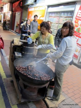 Roasted chestnuts sold as street food in Hong Kong, stir friedwith coals for that charred taste. I wasn't a fan.