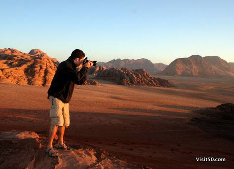 me photographing the beautiful sunrise in the desert in Wadi Rum, Jordan