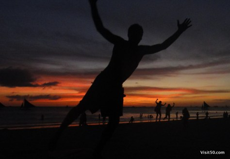 Jumping sunset silhouette pics in Boracay, Philippines, with kids jumping in the background