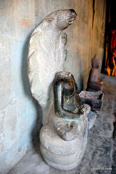 Angkor Wat statue missing its head after it got raided. They stole the heads!