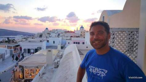 Santorini with iconic blue rooftops - it's more honeymoon vibe than backpacking Europe itinerary