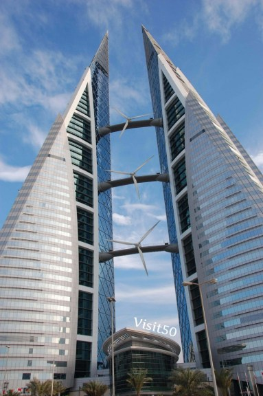 Bahrain World Trade Center - fascinating architecture design! See the 3 wind turbines between the buildings.