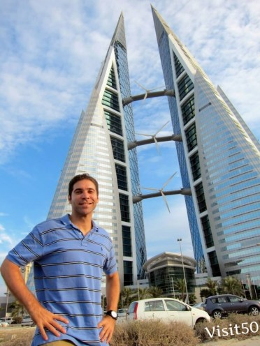 me at the Bahrain World Trade Center. Impressive wind turbines right on the building