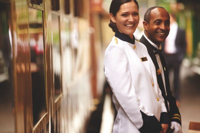 Smart attendants ready to help passengers aboard the Belmond British Pullman