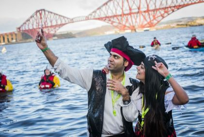 A man and woman standing in the River Forth at Edinburgh's Hogmanay Loony Dook photo by Chris Watt