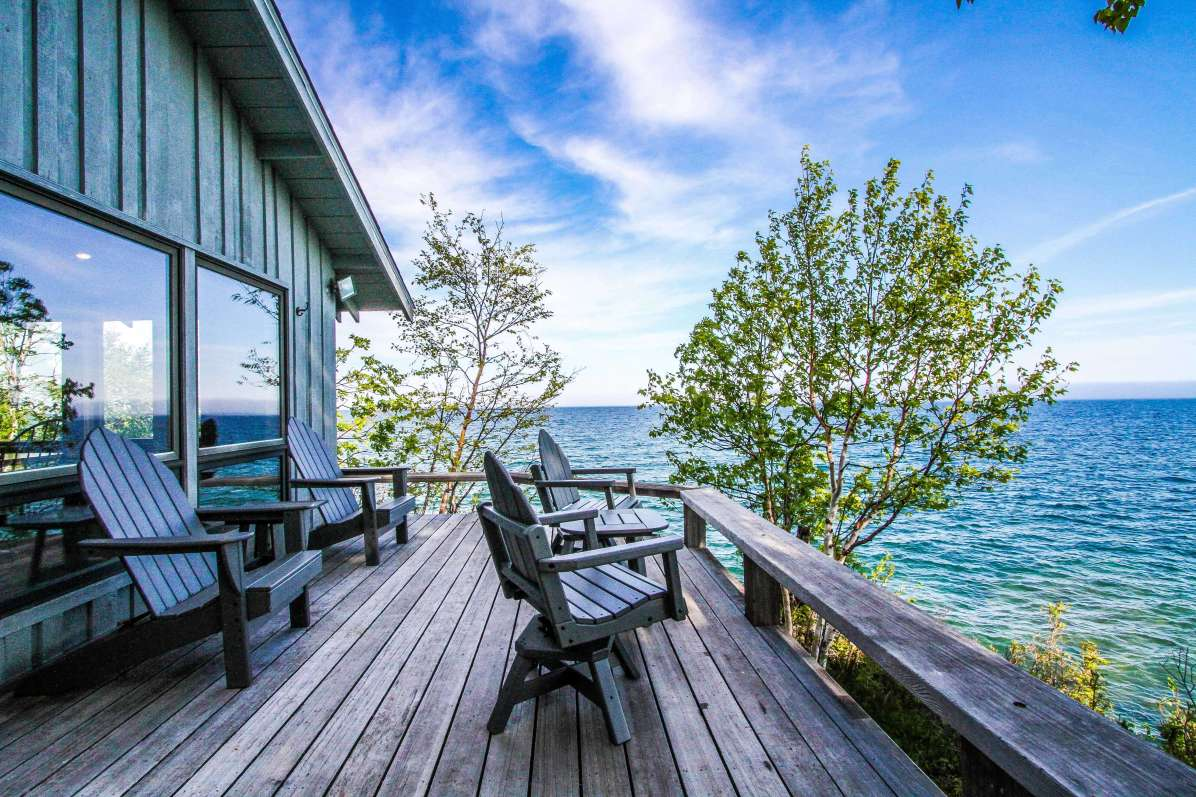 Cascade Vacation Rental image of home with deck overlooking Lake Superior