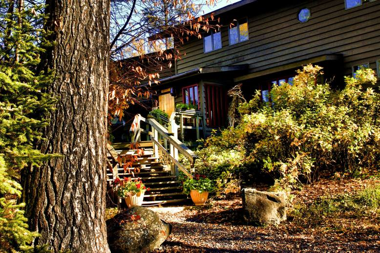 Bearskin Lodge & Outfitters entrance in fall