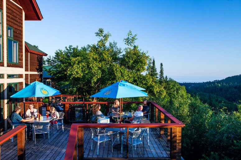People enjoy dining on the outdoor deck at Papa Charlies Tavern at Lutsen Mountains