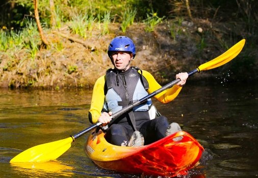 Alphie Rodgers, the new General Manager of Derg Isle Adventure Centre on a red and yellow sit-on-top kayak
