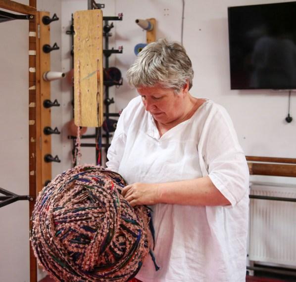Anke McKernan with a large ball of colourful yarn.