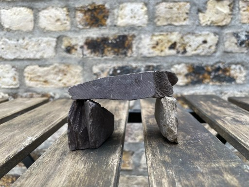 As part of the first East Clare Challenger, can you build a small dolmen using stones found nearby?