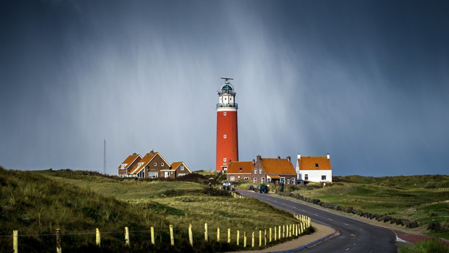 The red lighthouse on the Wadden Island of Texel in the rain