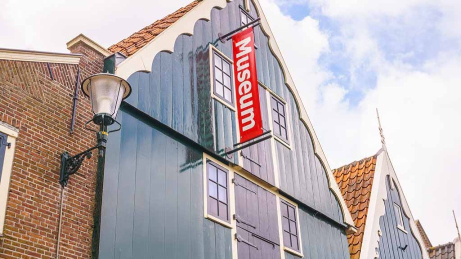 The top part of Museum in t houten huis in De Rijp. You see a lattern on the left side and the house itself is painted in the blue-green colour that many houses in De Rijp, The Netherlands, has