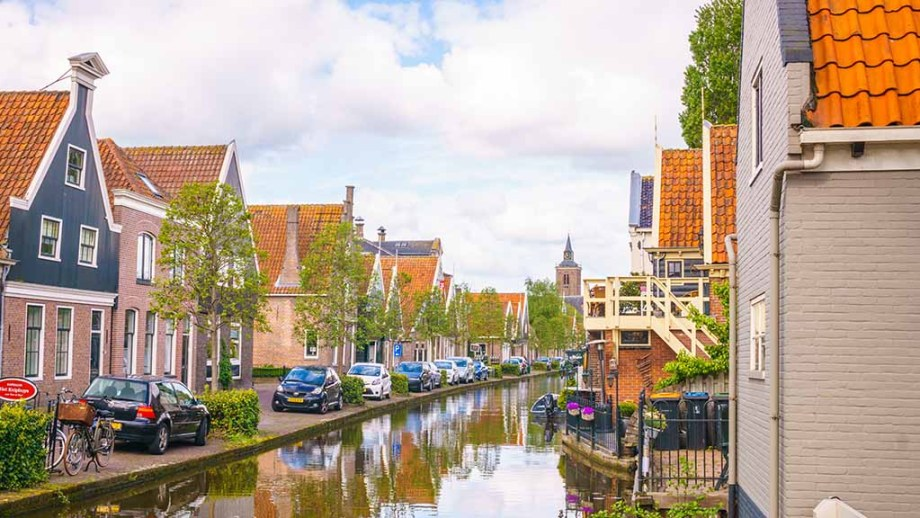 a view on a canal that flows through the historic Dutch village of De Rijp, The Netherlands