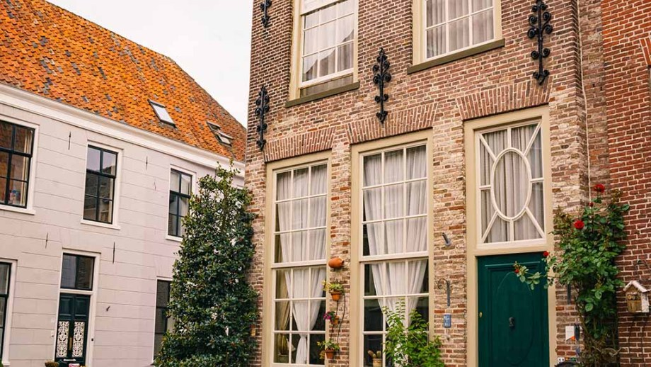 Beautiful canal houses in the old town of Grave, The Netherlands