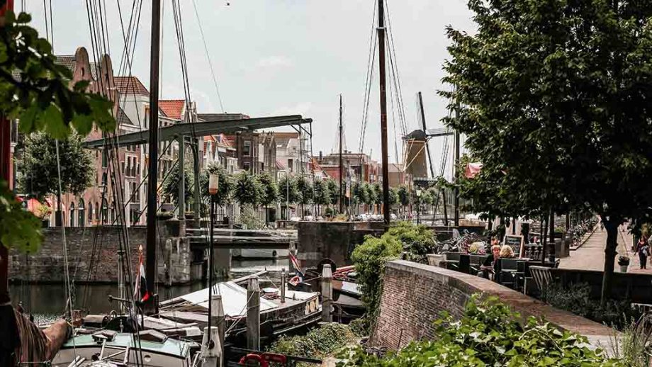 A view on Delfshaven, its harbour, old houses and windmill. Rotterdam, The Netherlands.