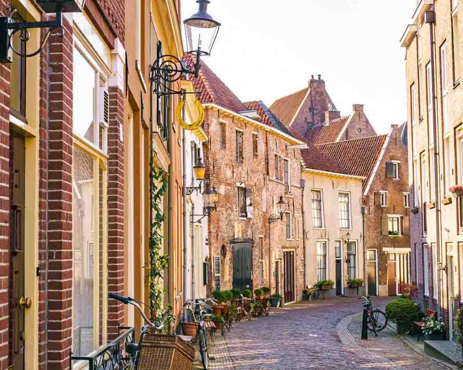 Beautiful brick houses and cobblestoned street in Deventer, The Netherlands