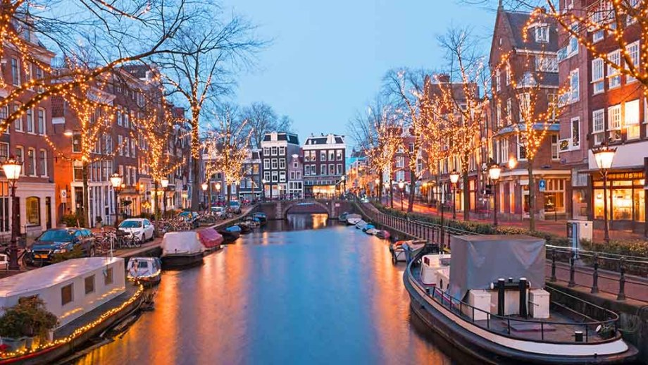 Amsterdam in winter with lights on the canals