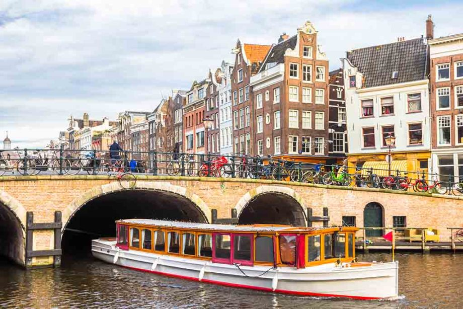 Amsterdam and its canals during winter with a canal boat