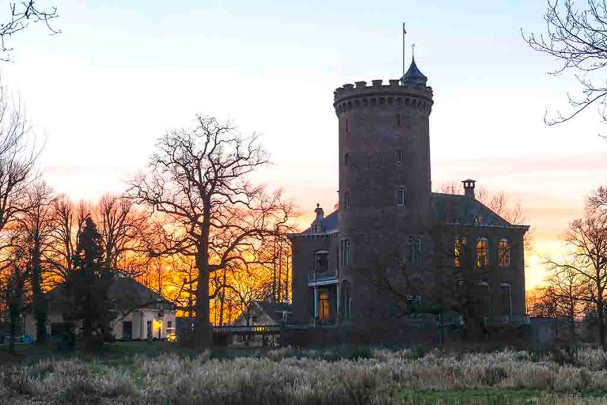 Sterkenburg at sunset near langbroek with a great and strong tower in orange light.