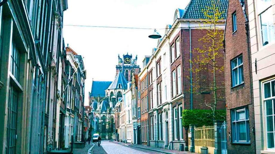 Street in Dutch city of Dordrecht with a view on the Grote Kerk, The Netherlands