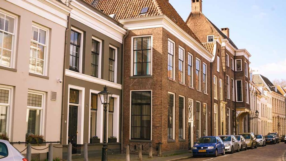 cobblestoned street with old Dutch houses in Zwolle, The Netherlands