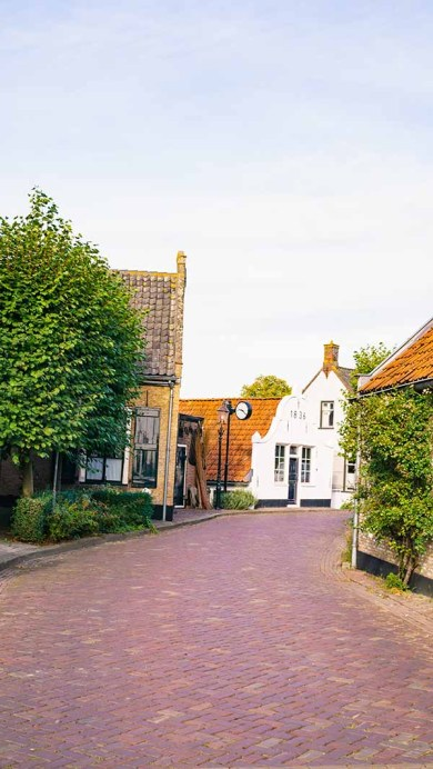 One of the beautiful streets, with old Dutch houses, in the most beautiful village in The Netherlands: Drimmelen