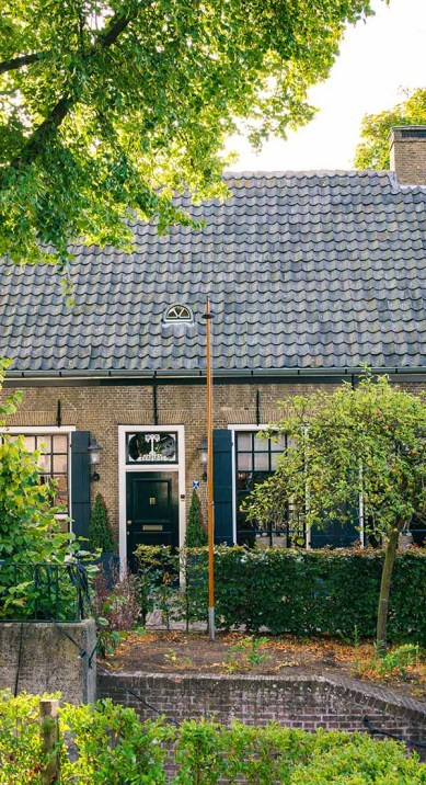 One of the brick and old Dutch houses in Drimmelen that is found next to the canal at the Herengracht