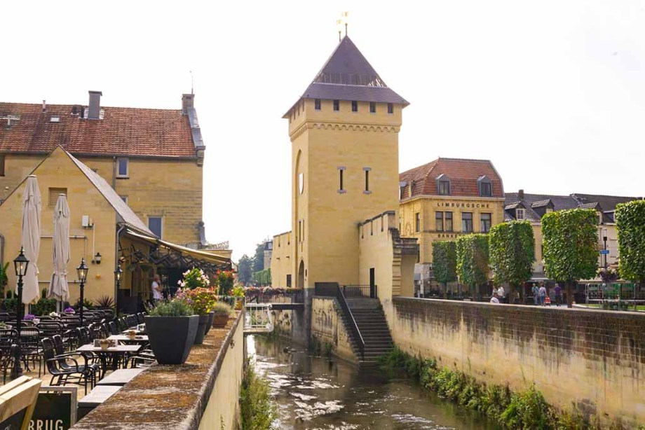 View on a river and old city gate in the city of Valkenburg, The Netherlands