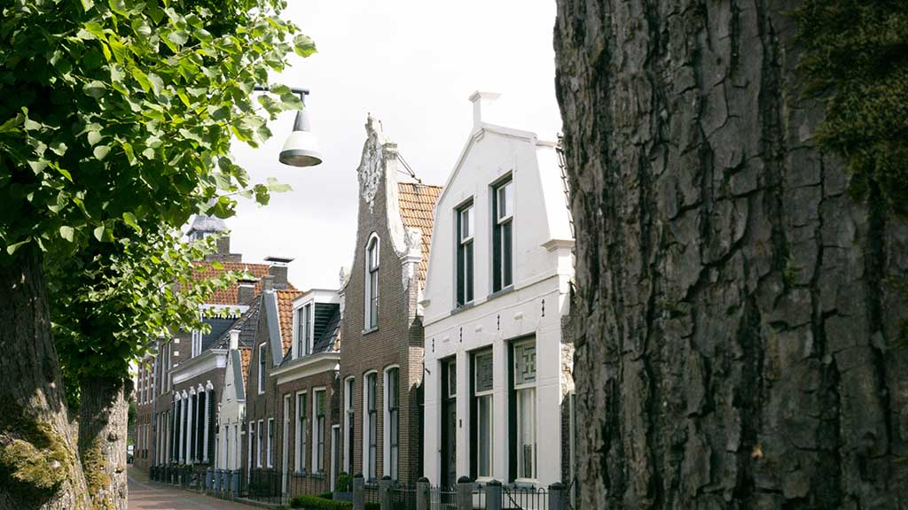 A view on traditional Dutch brown brick buildings with a facade in the village of Balk