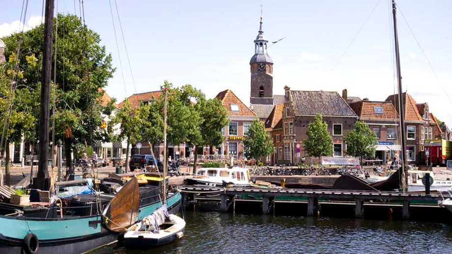 A view on the old harbour and old Dutch houses in the village of Blokzijl