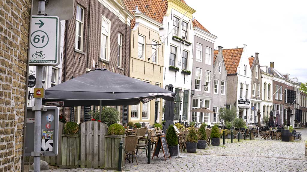 A view on the main square and old Dutch houses in the village of Goedereede, Zeeland, The Netherlands