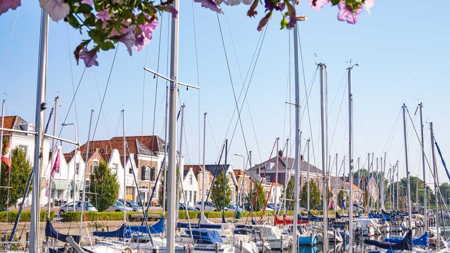 a view on the harbour with canal houses and sail boats of Brouwershaven, Zeeland, The Netherlands, on a sunny day