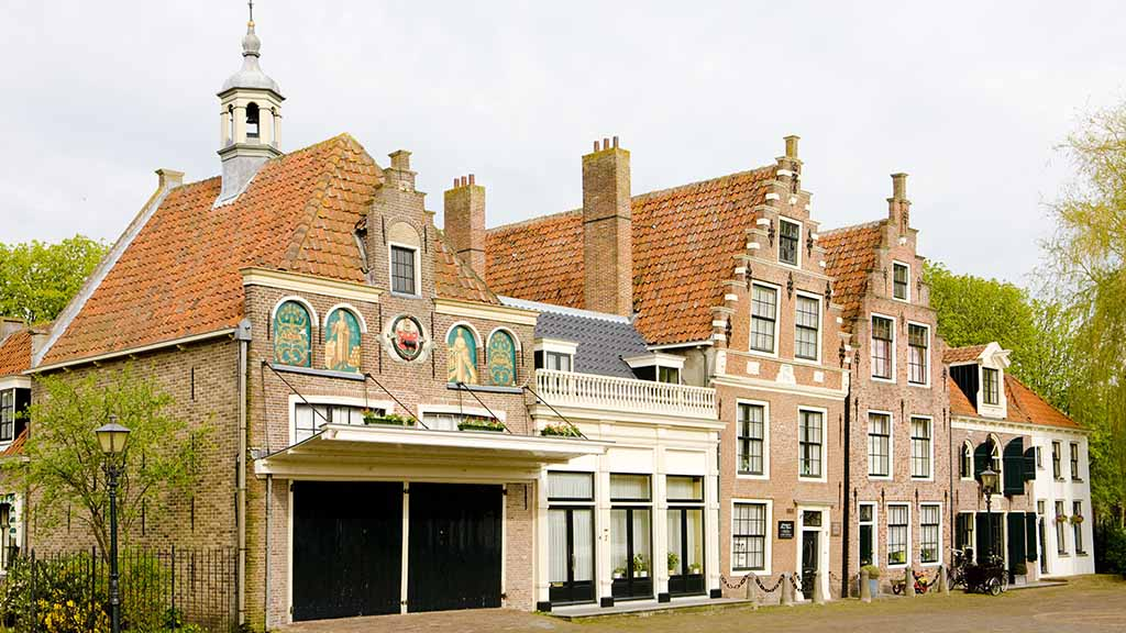 View on old Dutch brick houses in the village of Edam, The Netherlands