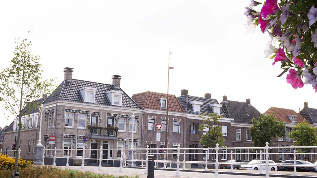 View on brick canal houses and a bridge in Genemuiden, Overijssel, The Netherlands