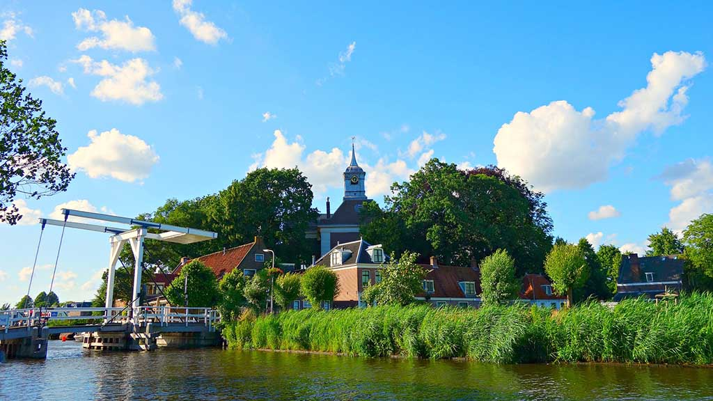 View on a canal and old Dutch village of Ouderkerk aan de Amstel, The Netherlands