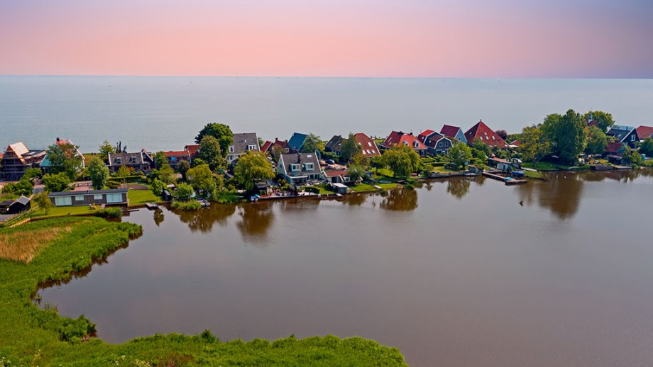 Aerial from the traditional village Uitdam at the IJsselmeer in the Netherlands at sunset