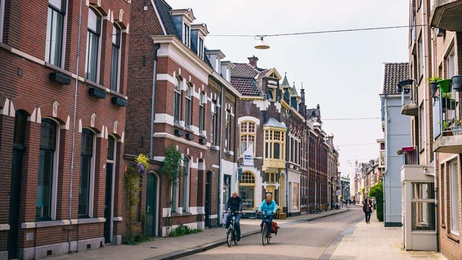 view on a street and Dutch historic buildings in the city of Tilburg, Noord- Brabant, The Netherlands