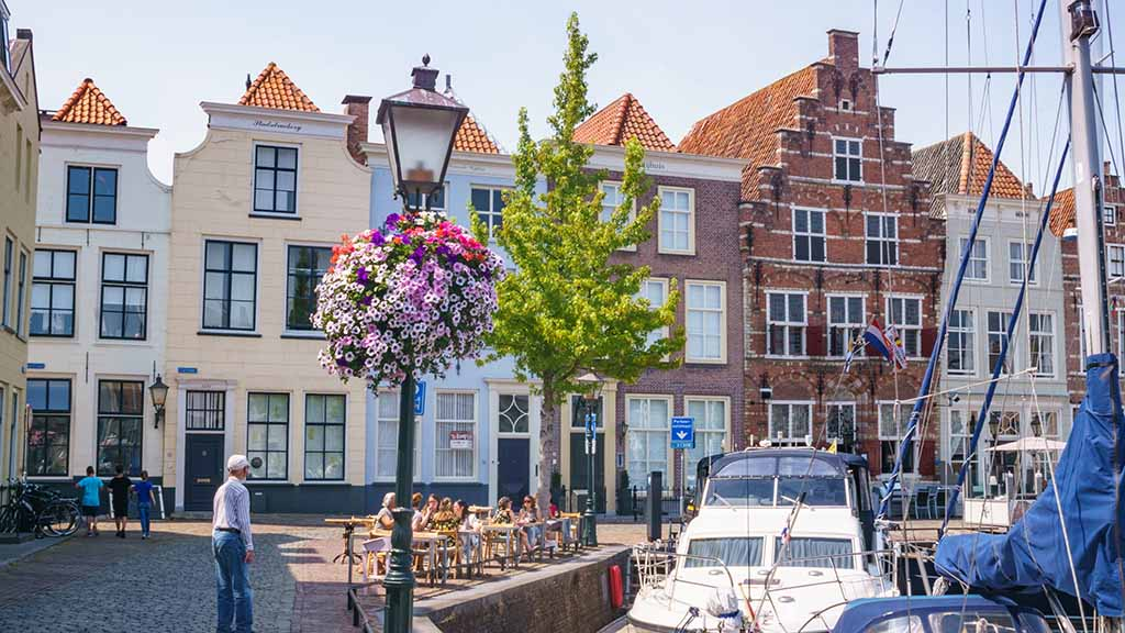 View on old harbour and canal houses in town of Goes, Zeeland, The Netherlands during summer