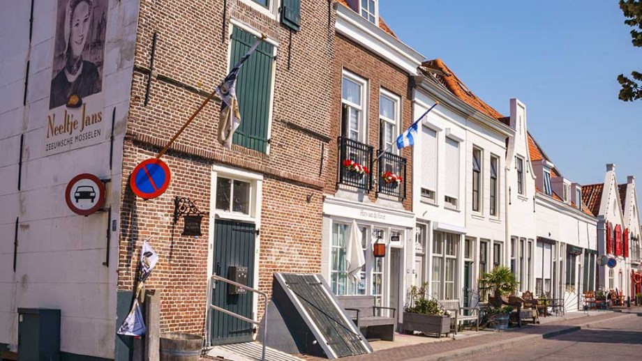 view on historic street with brick canal houses in city of Zierikzee, Zeeland, The Netherlands