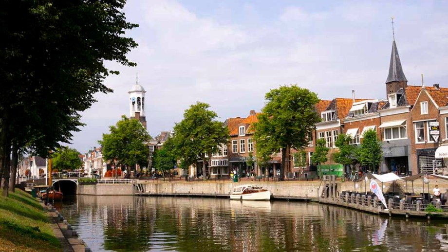 view on canal and canal houses in the city of Dokkum, Friesland, The Netherlands