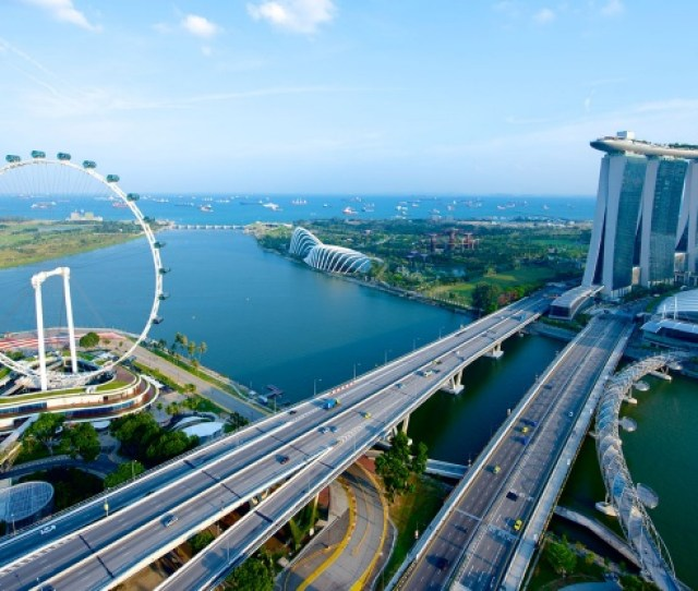 Aerial View Of The Iconic Singapore Skyline With The Singapore Flyer Marina Bay Sands