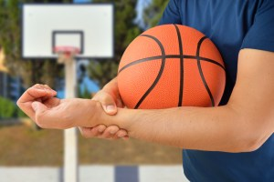 Royalty-free stock photo ID: 551113072 shot of a basketball player with a wrist injury at outdoors