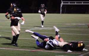 A Mountain Vista defensive player tackles a Douglas County player.
